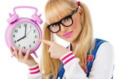 Muchacha hermosa del estudiante con el reloj Foto de archivo libre de regalías