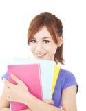 Muchacha hermosa del estudiante con los libros Aislado en el fondo blanco Imagen de archivo libre de regalías