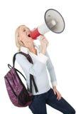 Muchacha hermosa del estudiante que grita en megáfono Imagen de archivo