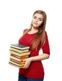 Muchacha hermosa del estudiante que sostiene los libros Fotografía de archivo libre de regalías