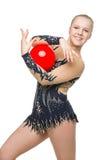 Muchacha hermosa del gimnasta con la bola roja Fotos de archivo