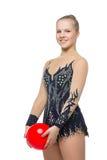 Muchacha hermosa del gimnasta con la bola roja Fotografía de archivo
