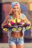 Muchacha hermosa del patinador del rodillo Imagenes de archivo