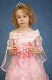 Muchacha hermosa en alineada rosada Foto de archivo libre de regalías