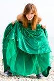Muchacha hermosa en alineada verde Foto de archivo libre de regalías