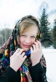 Muchacha hermosa en bufanda en fondo hivernal Imágenes de archivo libres de regalías
