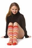 Muchacha hermosa en calcetines divertidos Imagenes de archivo