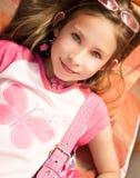 Muchacha hermosa en color de rosa Imagen de archivo libre de regalías