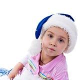 Muchacha hermosa en el sombrero de Santa Fotos de archivo