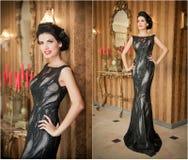 Muchacha hermosa en el vestido negro elegante que presenta en escena del vintage Mujer hermosa joven que lleva el vestido lujoso  Imágenes de archivo libres de regalías