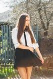 Muchacha hermosa en falda Imágenes de archivo libres de regalías