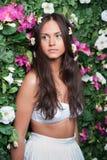 Muchacha hermosa en flores Fotografía de archivo libre de regalías