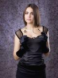 Muchacha hermosa en guantes Imagenes de archivo