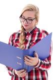 Muchacha hermosa en lentes con el libro en su mano aislada en w Imagen de archivo