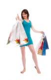 Muchacha hermosa en los bolsos azules a los compradores Imagenes de archivo