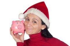 Muchacha hermosa en moneybox cariñoso de la Navidad Imagenes de archivo