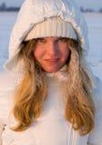 Muchacha hermosa en nieve Imagen de archivo libre de regalías