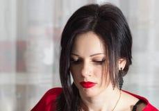 Muchacha hermosa en rojo Imagenes de archivo