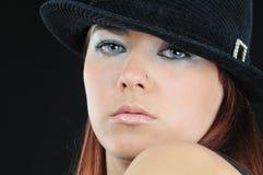 Muchacha hermosa en sombrero Fotografía de archivo libre de regalías
