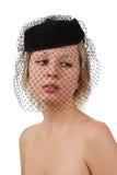 Muchacha hermosa en sombrero negro con velo Foto de archivo libre de regalías