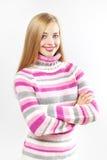 Muchacha hermosa en suéter coloreado Imagen de archivo libre de regalías