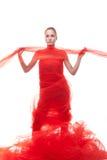 Muchacha hermosa en un paño rojo Foto de archivo libre de regalías
