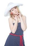 Muchacha hermosa en un sombrero del verano sobre blanco Fotografía de archivo libre de regalías
