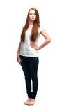 Muchacha hermosa en una camiseta blanca Aislado en el fondo blanco Imagen de archivo