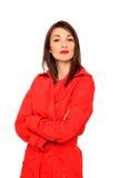 Muchacha hermosa en una capa roja Foto de archivo
