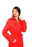 Muchacha hermosa en una capa roja Fotografía de archivo