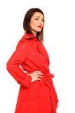Muchacha hermosa en una capa roja Foto de archivo libre de regalías