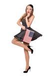 Muchacha hermosa en vestido negro con la bandera americana Imagen de archivo libre de regalías