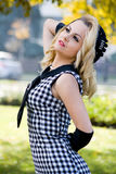 Muchacha hermosa en vestido y guante Imagen de archivo