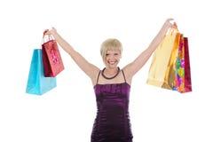 Muchacha hermosa feliz con los bolsos de compras. Imágenes de archivo libres de regalías