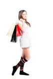 Muchacha hermosa feliz con los bolsos de compras Foto de archivo libre de regalías