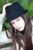 Muchacha hermosa joven en un sombrero Foto de archivo libre de regalías