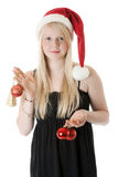 Muchacha hermosa joven en un sombrero de Santa fotos de archivo libres de regalías