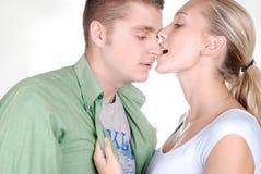Muchacha hermosa joven que mordisca su novio Fotografía de archivo libre de regalías