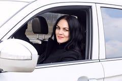 Muchacha hermosa que conduce un coche Fotografía de archivo libre de regalías