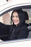 Muchacha hermosa que conduce un coche Imagen de archivo