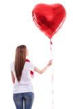 Muchacha hermosa que lleva a cabo el corazón Foto de archivo