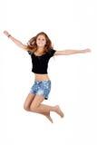 Muchacha hermosa que salta, funcionamiento del adolescente aislado Imágenes de archivo libres de regalías