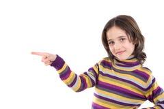 Muchacha hermosa que señala con su dedo Fotografía de archivo