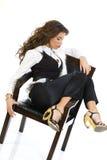 Muchacha hermosa que se sienta en la silla Imagen de archivo