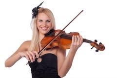 Muchacha hermosa que toca el violín Foto de archivo libre de regalías