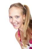 Muchacha hermosa sonriente aislada en un blanco Foto de archivo