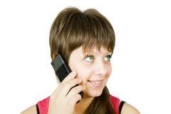 Muchacha hermosa sonriente con el teléfono Imagenes de archivo
