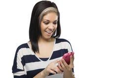 Muchacha hermosa Texting Foto de archivo libre de regalías