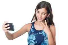 Muchacha hispánica joven que se toma un retrato Fotografía de archivo libre de regalías