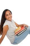 Muchacha india feliz con los libros que se sientan en el piso Fotografía de archivo libre de regalías